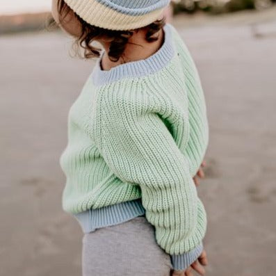 Le Edit Sea Sky Contrast Knit Jumper with Blue Beanie at the beach