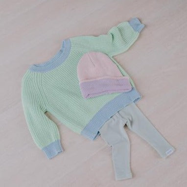 Le Edit Sea Sky Contrast Knit Jumper with Pink Beanie and Grey Leggings