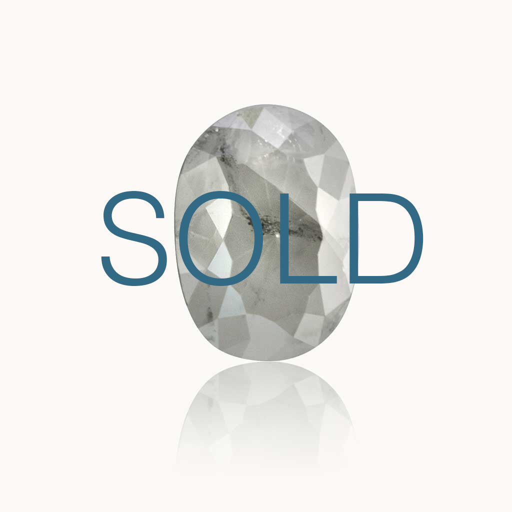 SOLD 0.98 ct. Milky Grey Oval Diamond