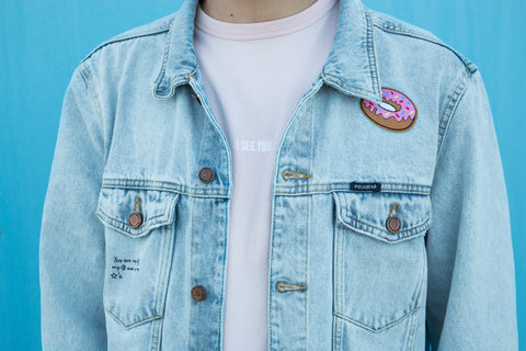 Man Wearing Denim Jacket Upcycled With Pink Donut Patch