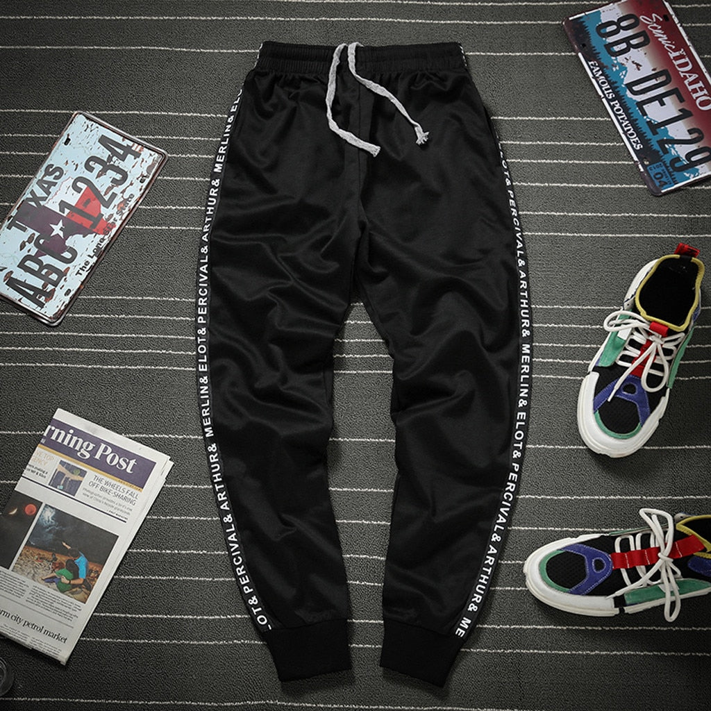 Men's jogging sports sweatpants loose plus size elastic pants Male stitching drawstring pocket trousers fitness running pants