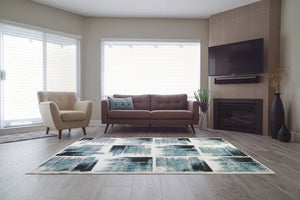 Kensington Teal Ivory Abstract Area Rug -