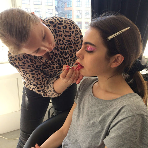 Glitterazzi Glitter Artist Sandra Gimmel applying bioglitter on model Nicole