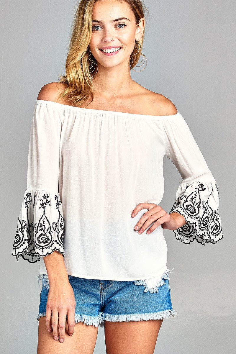 Ladies fashion 3/4 sleeve w/floral embo scallop hem off the shulder woven top
