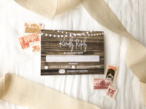 This rustic wooden wedding invitation suite has gorgeous string lights as well. This invitation suite is perfect for weddings in a barn, in the country, or outdoors. You can add a details card and RSVP card to complete your suite!