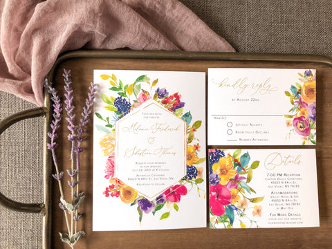 Bright floral wedding invitations. These are the perfect wedding invitations with wild flowers. They are great for spring and summer weddings.