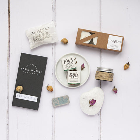 Alice & Peg In Bloom Box - Vegan New Mum and Mummy to Be Pamper Gift Hamper Set. Featuring handmade dark chocolate, bump balm, vegan lip butter, foot soak cubes, calming candles and organic tea.