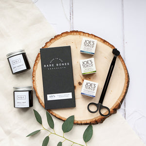 Alice & Peg Hygge Box - Vegan luxury candles and chocolate gift set.  Featuring two hand poured soy wax candles, luxury candle wick trimmer, handmade single origin chocolate bar and set of three cup ready organic teas.