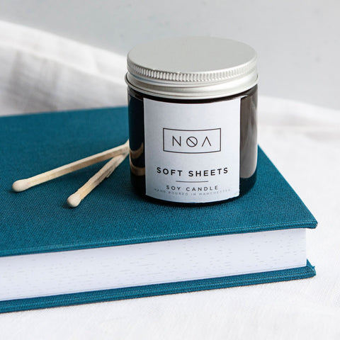Alice & Peg Hygge Box - Vegan luxury candles and chocolate gift set. Featuring two hand poured amber jar soy wax candles, made in Manchester by NOA candles.