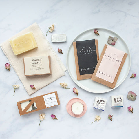 Alice & Peg Live The Little Things Box - Thoughtful ethical letterbox gift set featuring handmade chocolate, handmade soap, handpoured palm-oil-free candles, handmade lip butter, and two cup ready organic teas.