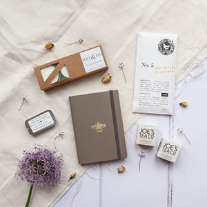 Alice & Peg Thoughts Box - Thoughtful letterbox gift set - Featuring a handmade recycled leather notebook, handmade bee pollen raw chocolate bar, recycled glass tealights, calm balm and set of two calming cup ready organic teas.