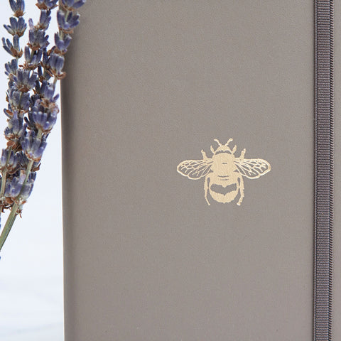 Alice & Peg Thoughts Box - Thoughtful letterbox gift set - Featuring a handmade recycled leather pocket notebook, made in the UK by Undercover. Taupe colour with gold bumble accent.