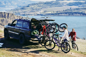Lolo Rack - The best 6 bike vertical rack, with mountain bikes next to a lake