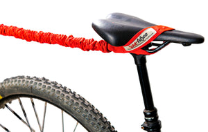 TowWhee Bike bungee tow strap red looped onto seat