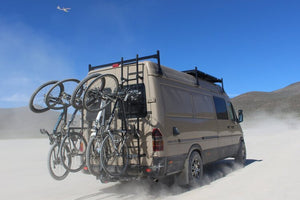 Sprinter van with 6 bike vertical Lolo Rack. Mountain bikes and road bikes