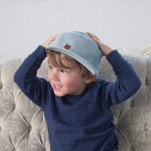 Kid with blue corduroy 5 panel kids hat by XS Unified