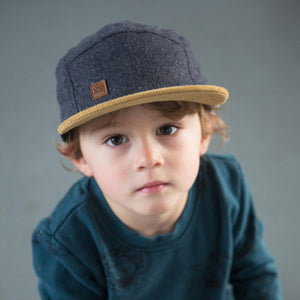 Kid with Wool 5 panel wool kids hat by XS Unified