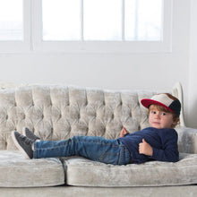 Kids 5 panel hat earth colour block on boy on couch
