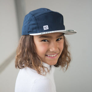 Kids 5 panel hat navy tropical on girl