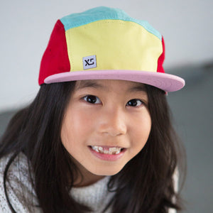 Kids 5 panel hat pastel colour block on girl