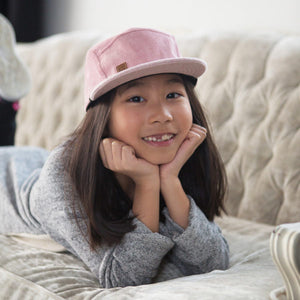 Kid with pink corduroy 5 panel kids hat by XS Unified