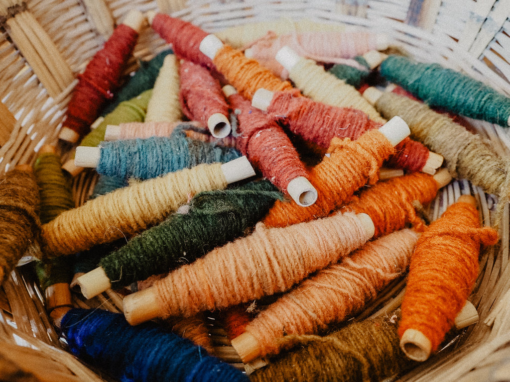 spools of wool yarn naturally dyed