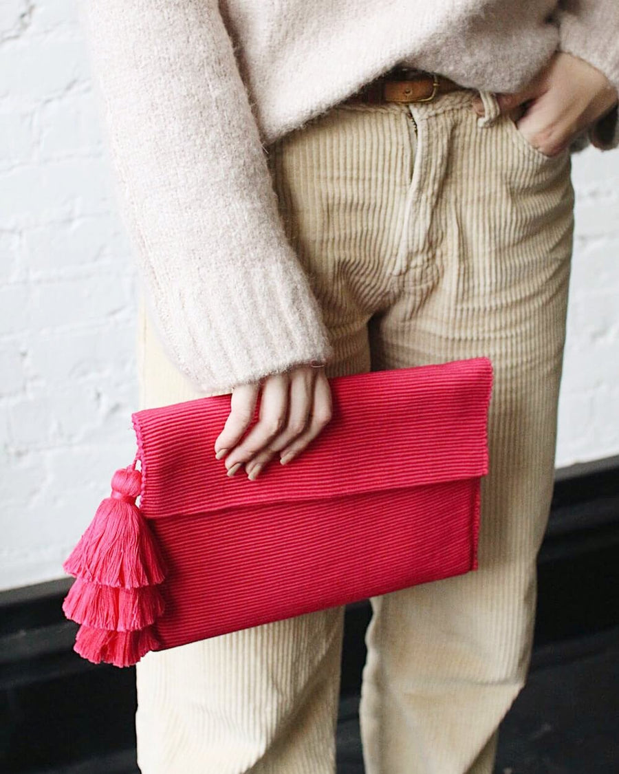 Ande Handwoven Tassel Clutch in Vibrant Pink