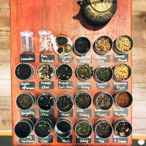 A display of 24 loose leaf teas, including herbal tea, oolong tea, green tea, chai tea, black tea and flavoured black tea