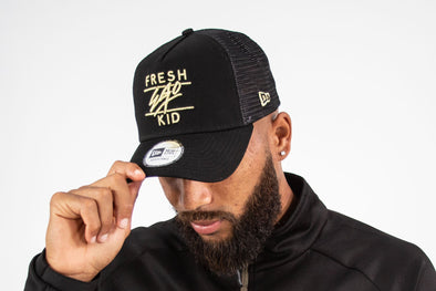 NEW ERA BLACK/GOLD MESH TRUCKER