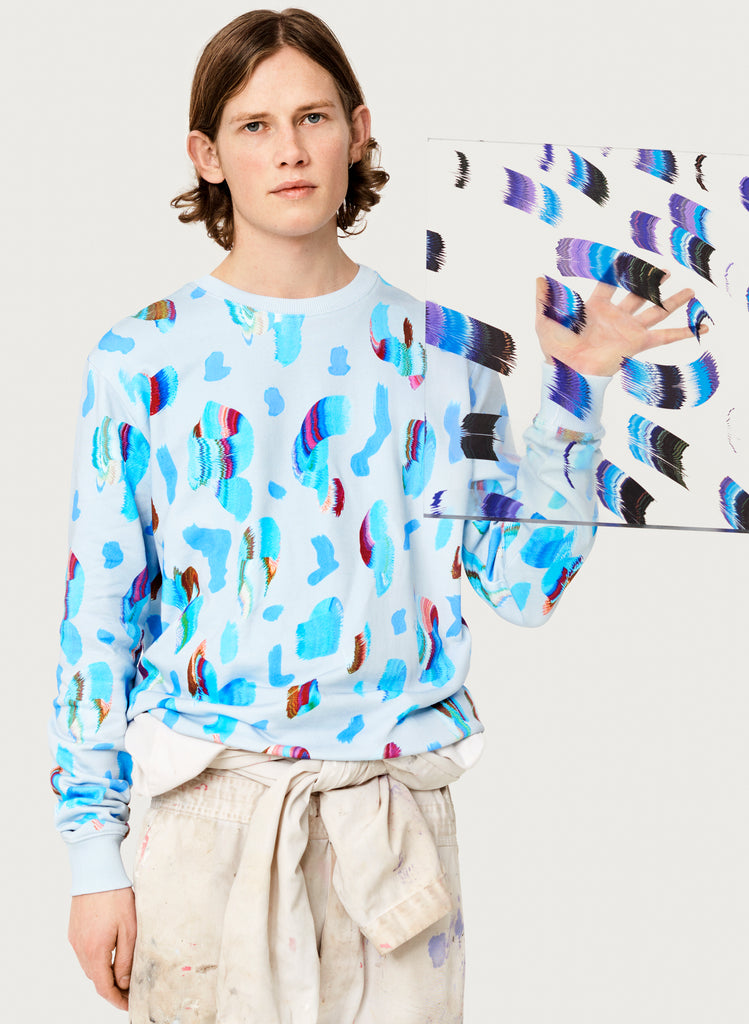 Male model wearing wearable art sweatshirt. Blue hoodie with artsy design made from organic cotton. Artistic version.
