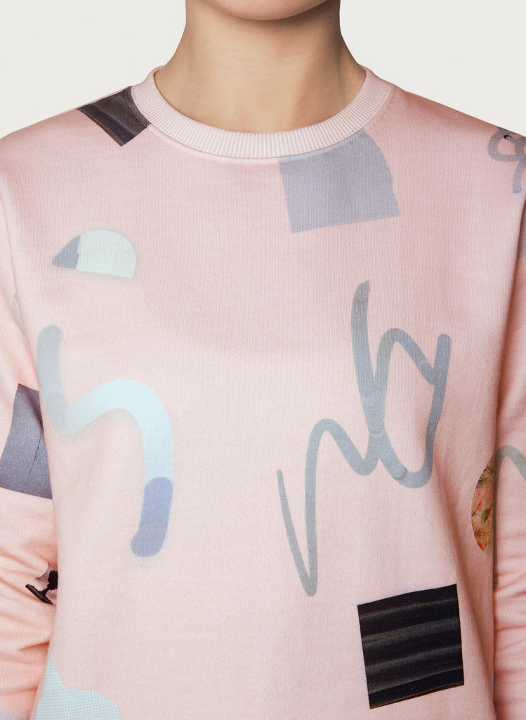 Woman with wearable art sweatshirt on. Pink-coloured hoodie, minimalistic design, made from sustainable material. Front picture zoom.