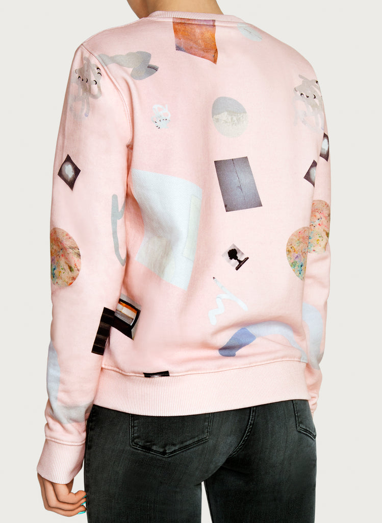 Woman with wearable art sweatshirt on. Pink-coloured hoodie, minimalistic design, made from sustainable material. Back picture.