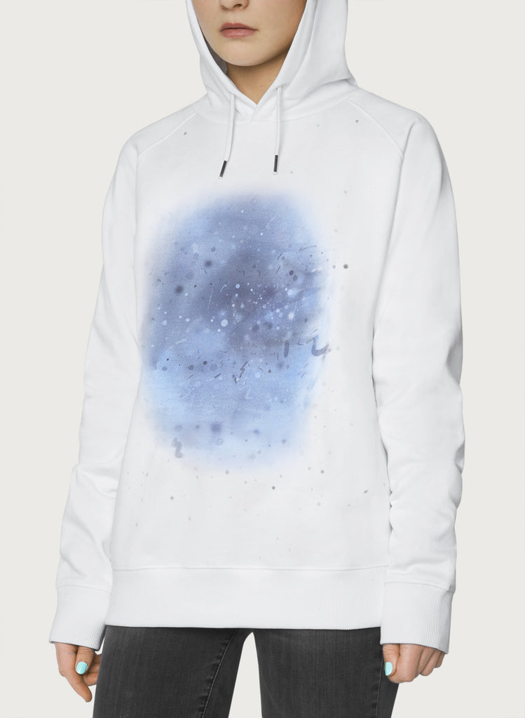 Female model wearing white sweatshirts with blue, artistic design. Wearable art, unisex hoodie for him and her. Front picture.