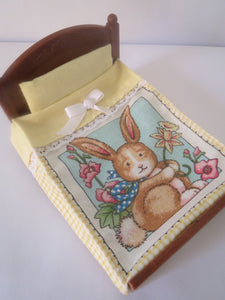 Sylvanian Double Bedspread Plain Matching Yellow Pillow,the bed spread has a cute picture of a rabbit holding a flower has yellow trims.