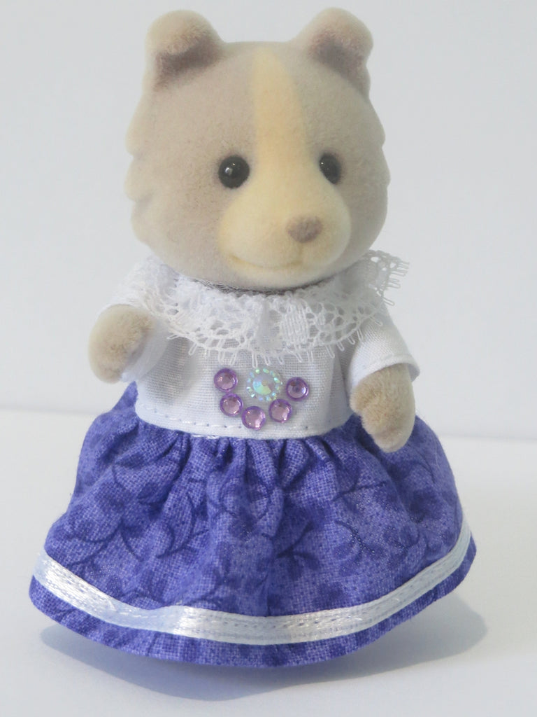 Sylvanian Mothers Dress White bodice with white lace frilled around the neckline and purple diamonds on the front attached to the bodice is a purple skirt with white ribbon sewn around the hemline.