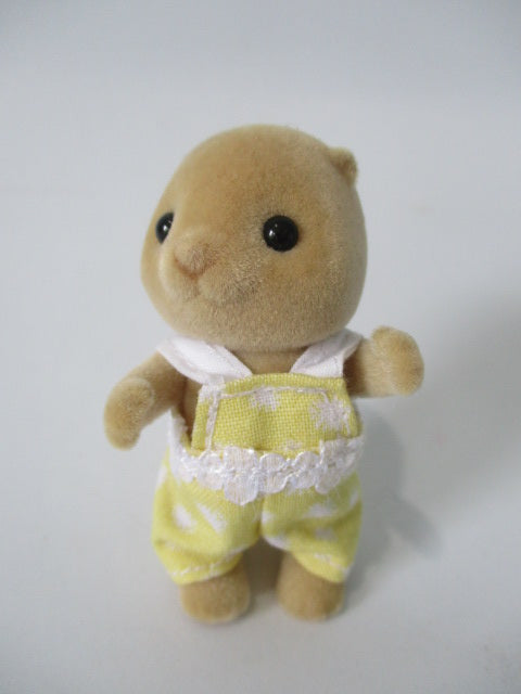 Sylvanian baby playsuit yellow with white spots.