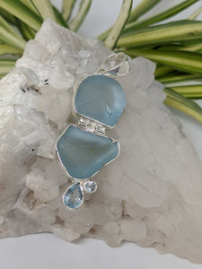 Multi-stone pendant - Raw and faceted blue topaz