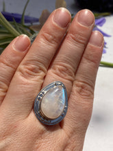 Moonstone teardrop split band ring with a decorative setting s.8