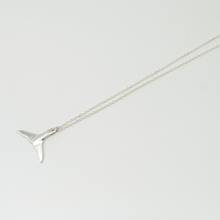 Silver whale's tail necklace
