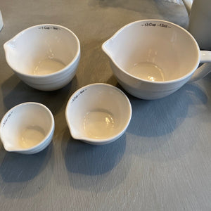 Creamy white measuring cups