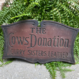 Curry Sisters Leather sign