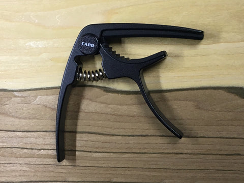 Black acoustic / electric guitar capo