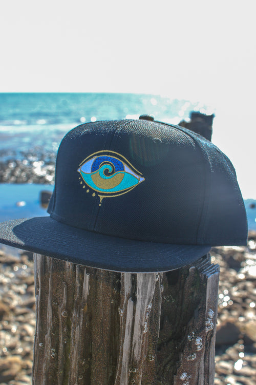 navy embroidered SEANOE snapback cap