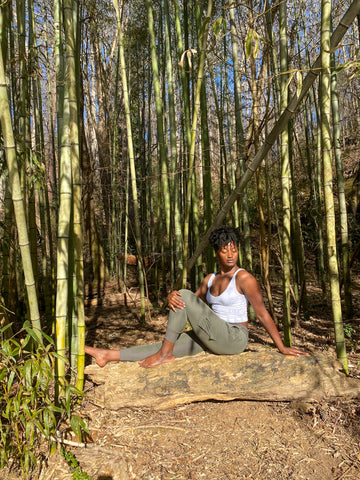 Woman doing yoga in a bamboo forest