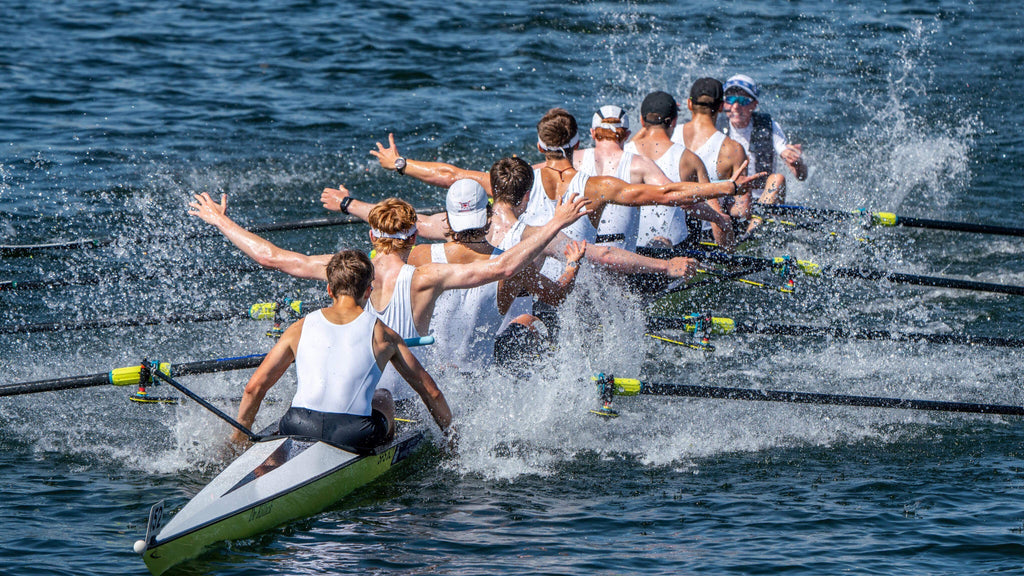 St Paul's School 1st 8 cross the finish line celebrating at Henley 2018