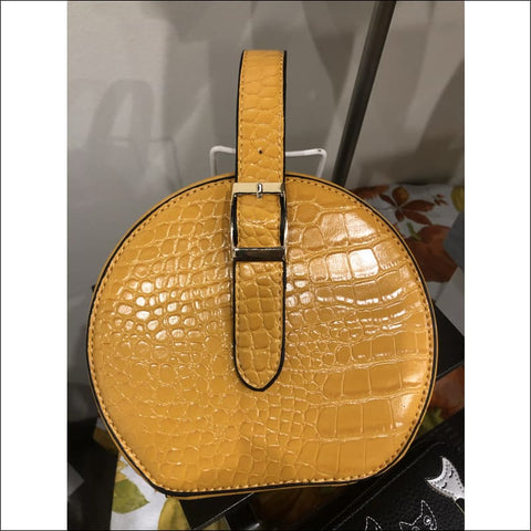 yellow crocodile purse