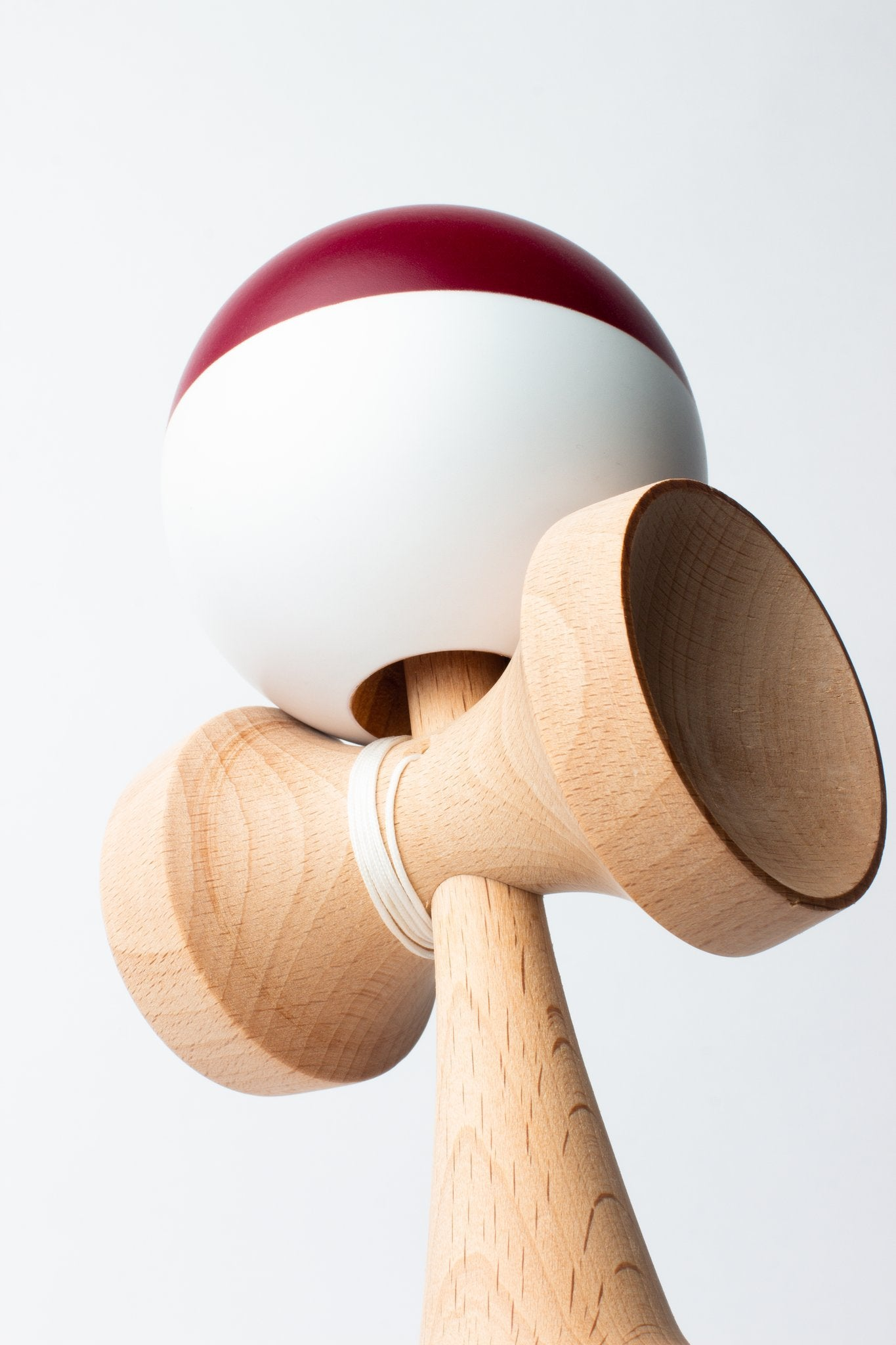 Sweets Maroon/White Cushion Clear Sumo Kendama angle