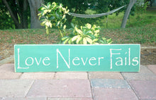 Load image into Gallery viewer, 18x4 Love Never Fails Wood Family Sign