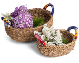 Table or storage baskets with cloth handles two baskets shown filled with flowers