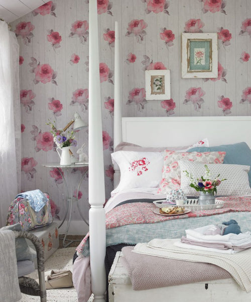 Pink and white floral wall painting in a bedroom